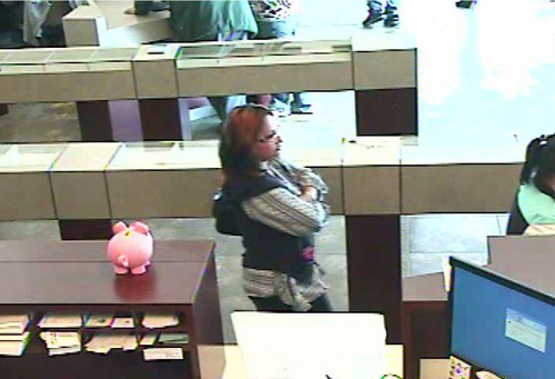 Courtesy   West Valley Police Department. Police in West Valley City believe this unidentified woman is one of two suspects in two fake diamond scams that have been reported in Orem and West Valley City in the past month.