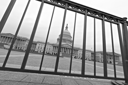 The Capitol plaza is seen as automatic spending cuts are set to take effect on March 1, in Washington, Tuesday, Feb. 26, 2013. (AP Photo/J. Scott Applewhite)
