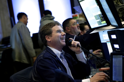 A trader works on the floor at the New York Stock Exchange in New York, Wednesday, Feb. 27, 2013. Stocks closed sharply higher for a second day on Wednesday, as evidence mounts that the housing market is making a comeback. (AP Photo/Seth Wenig)