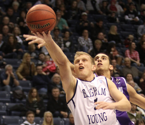 Rick Egan  | The Salt Lake Tribune   Brigham Young Cougars guard Tyler Haws (3) takes the ball to the hoop, in basketball action, as the BYU Coiugars played the Portland Pilots, at the Marriott Center, Saturday, February 16, 2013.