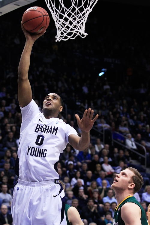 BYU's Brandon Davies lays it up during an NCAA college basketball game  San Francisco at the Marriott Center in Provo, Utah on Saturday, Feb. 9, 2013. San Francisco won 99-87.  (AP Photo/Daily Herald, Spenser Heaps)