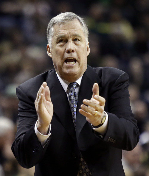 California coach Mike Montgomery claps during the first half of an NCAA college basketball game against Oregon in Eugene, Ore., Thursday, Feb. 21, 2013. (AP Photo/Don Ryan)