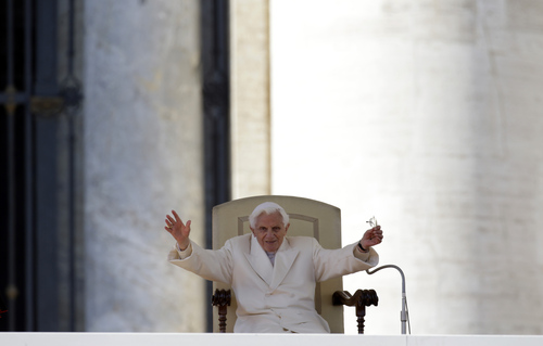"""Pope Benedict XVI waves to faithful during his final general audience in St.Peter's Square at the Vatican, Wednesday, Feb. 27, 2013. Pope Benedict XVI has recalled moments of """"joy and light"""" during his papacy but also times of great difficulty in an emotional, final general audience in St. Peter's Square before retiring. (AP Photo/Gregorio Borgia)"""