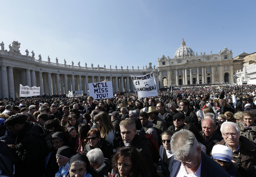"""Faithful leave at the end of Pope Benedict XVI's last general audience in St. Peter's Square, at the Vatican, Wednesday, Feb. 27, 2013. Benedict XVI basked in an emotional sendoff Wednesday at his final general audience in St. Peter's Square, recalling moments of """"joy and light"""" during his papacy but also times of great difficulty. He also thanked his flock for respecting his decision to retire. (AP Photo/Alessandra Tarantino)"""
