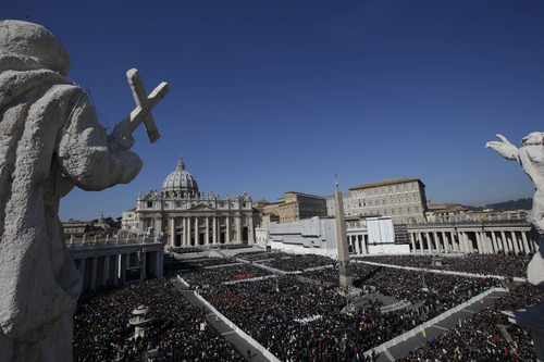 """A view of the crowd in St. Peter's Square during Pope Benedict XVI's last general audience in St. Peter's Square, at the Vatican, Wednesday, Feb. 27, 2013. Benedict XVI basked in an emotional sendoff Wednesday at his final general audience in St. Peter's Square, recalling moments of """"joy and light"""" during his papacy but also times of great difficulty. He also thanked his flock for respecting his decision to retire. (AP Photo/Andrew Medichini)"""
