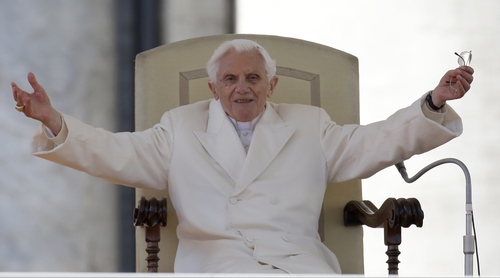 """Pope Benedict XVI opens his arms during his final general audience in St. Peter's Square at the Vatican, Wednesday, Feb. 27, 2013. Pope Benedict XVI basked in an emotional sendoff Wednesday at his final general audience in St. Peter's Square, recalling moments of """"joy and light"""" during his papacy but also times of great difficulty. He also thanked his flock for respecting his decision to retire. (AP Photo/Gregorio Borgia)"""
