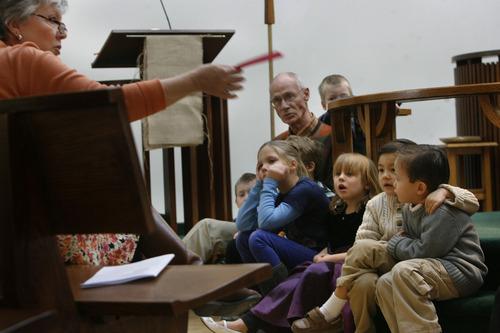 "Scott Sommerdorf   |  The Salt Lake Tribune Robin Eskridge, left, leads the ""Children's Sermon"" held around the circular center of the worship hall at Mount Tabor Lutheran in Salt Lake City, Sunday, Feb. 15, 2013."