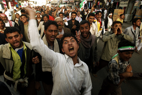 Yemeni pro-democracy protestors chant slogans as they march during a demonstration demanding the trial of former president Ali Abdullah Saleh in Sanaa, Yemen, Thursday, Feb. 28, 2013. (AP Photo/Hani Mohammed)