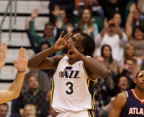 Trent Nelson  |  The Salt Lake Tribune Utah Jazz small forward DeMarre Carroll (3) celebrates after hitting a three-pointer in the fourth quarter as the Utah Jazz host the Atlanta Hawks, NBA basketball Wednesday, February 27, 2013 in Salt Lake City.