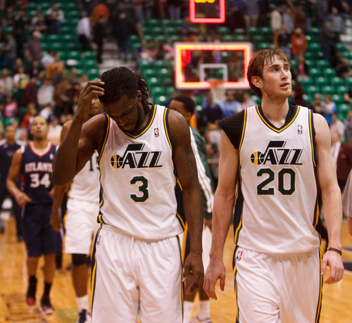 Trent Nelson  |  The Salt Lake Tribune Utah Jazz small forward DeMarre Carroll (3) and Utah Jazz shooting guard Gordon Hayward (20) walk off the court following the loss as the Utah Jazz host the Atlanta Hawks, NBA basketball Wednesday, February 27, 2013 in Salt Lake City.
