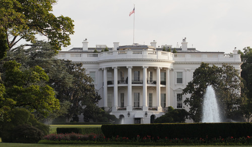 The White House is seen early Sunday, July 31, 2011. (AP Photo/Carolyn Kaster)
