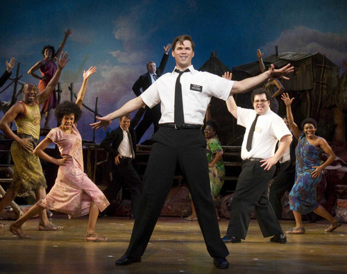"File photo | The Associated Press  Andrew Rannells, center, performs with an ensemble cast in ""The Book of Mormon."" The smash musical sold out all 23 performances for its Aug. 14-Sept. 2 run at Denver Center, where its launching its first national tour. There's a chance it may play at the proposed Utah Performing Arts Center, scheduled for completion March 2016."