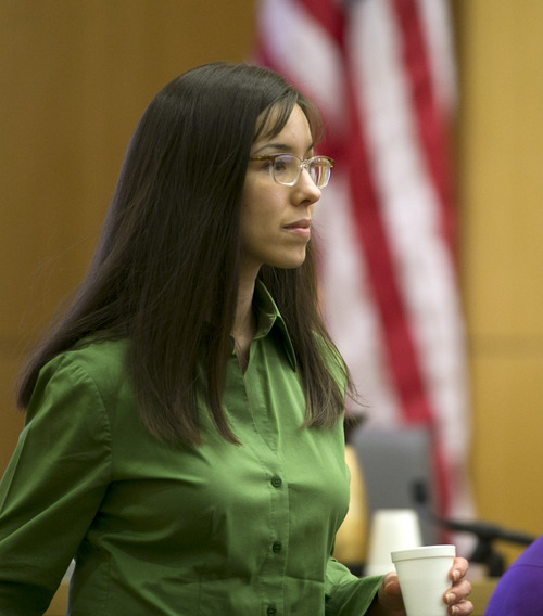 Jodi Arias walks off the witness stand during the Jodi Arias trial at Maricopa County Superior Court in Phoenix on Wednesday, Feb. 27, 2013. Arias is charged in the June 2008 death of her lover in his suburban Phoenix home. She says it was self-defense, but police say she planned the attack on Travis Alexander in a jealous rage. (AP Photo/The Arizona Republic, David Wallace, Pool)