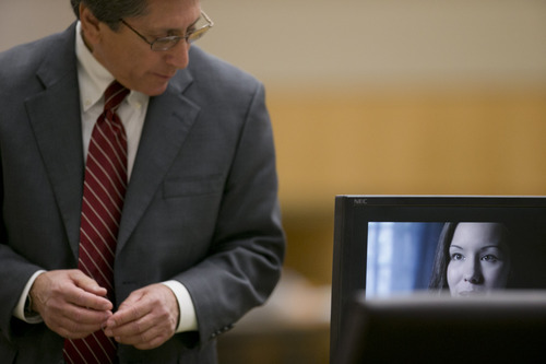 Prosecutor Juan Martinez, left, plays a clip from Jodi Arias appearing on the news show 48 Hours during the her trial at Maricopa County Superior Court in Phoenix on Wednesday, Feb. 27, 2013. Arias is charged in the June 2008 death of her lover in his suburban Phoenix home. She says it was self-defense, but police say she planned the attack on Travis Alexander in a jealous rage. (AP Photo/The Arizona Republic, David Wallace, Pool)