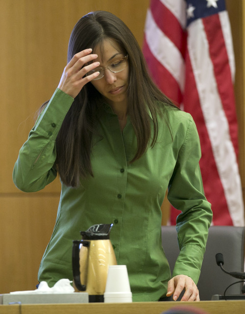 Jodi Arias sits down on the witness stand during the Jodi Arias trial at Maricopa County Superior Court in Phoenix on Wednesday, Feb. 27, 2013. Arias is charged in the June 2008 death of her lover in his suburban Phoenix home. She says it was self-defense, but police say she planned the attack on Travis Alexander in a jealous rage. (AP Photo/The Arizona Republic, David Wallace, Pool)