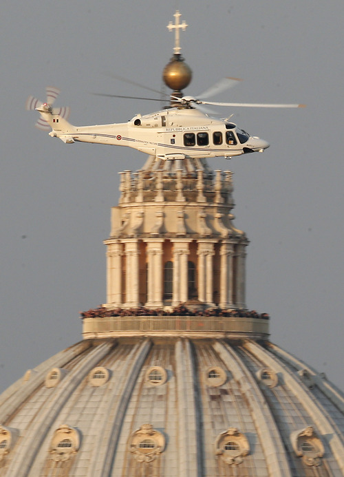 A helicopter with Pope Benedict XVI onboard leaves the Vatican in Rome, Thursday, Feb. 28, 2013. The 85-year-old German Pope Benedict is stepping down on Thursday evening, the first pope to do so in 600 years, after saying he no longer has the mental or physical strength to vigorously lead the world's 1.2 billion Catholics. (AP Photo/Michael Sohn)