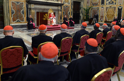 "In this photo provided by the Vatican newspaper L'Osservatore Romano, Pope Benedict XVI, top center, delivers his message on the occasion of his farewell meeting to cardinals, at the Vatican, Thursday, Feb. 28, 2013. Benedict XVI promised his ""unconditional reverence and obedience"" to his successor in his final words to his cardinals Thursday, a poignant farewell before he becomes the first pope in 600 years to resign. (AP Photo/L'Osservatore Romano, ho)"