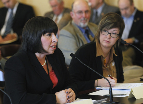 Al Hartmann  |  The Salt Lake Tribune Rep. Angela Romero, D-Salt Lake, left, sponsor of HB150 speaks before the House Natural Resources, Agriculture, and Environment Committee Thursday Febraury 28.  The bill would require animal shelters to adopt a euthanasia policy and training program and prohibits, with certain exceptions, an animal shelter from using carbon monoxide gas to euthanize an animal. The bill passed out of committee.  At right is Jamie Usry with the Humane Society of Utah which supports the bill.