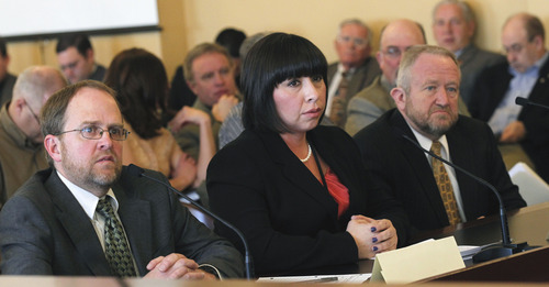 Al Hartmann  |  The Salt Lake Tribune Dr. Drew Allen with Utah Veterinary Medical Association, left, Rep. Angela Romero, D-Salt Lake, sponsor of HB150, and Russ Wall former Taylorsville mayor, speak before the House Natural Resources, Agriculture, and Environment Committee Thursday Febraury 28.  HB150, which passed out of committee, would require animal shelters to adopt a euthanasia policy and training program and prohibits, with certain exceptions, an animal shelter from using carbon monoxide gas to euthanize an animal.