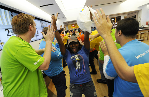 An enthusiastic customer experiences the Microsoft retail store at the Christiana Mall for the first time in Newark, Del., Saturday, Sept. 29, 2012. Courtesy photo