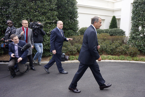 House Speaker John Boehner of Ohio walks away from reporters outside the White House in Washington, Friday, March 1, 2103, without taking questions, after a meeting with President Barack Obama and Congressional leaders regarding the automatic spending cuts. (AP Photo/Charles Dharapak)
