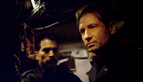 "This film image released by RCR Media Group shows David Duchovny, right, and Johnathon Schaech in a scene from ""Phantom."" (AP Photo/RCR Media Group)"