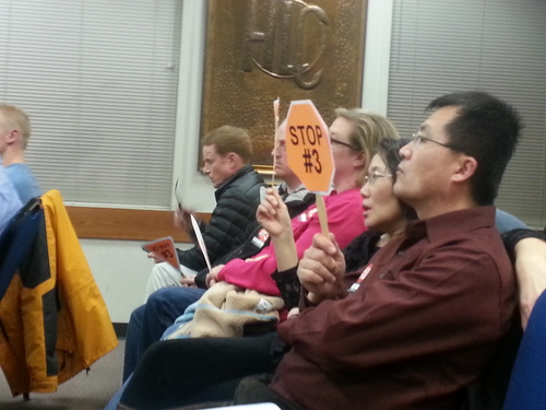 "Herriman residents packed the council chambers Thursday, Feb. 28, holding orange octagon-shaped signs stating ""Stop #3"" or wore stickers that said the same. The city council decided during the discussion to have the city move forward with a gun range, but not with plans for a temporary site at location three, which was within just more than a mile of homes, two elementary schools and three churches. Cimaron Neugebauer
