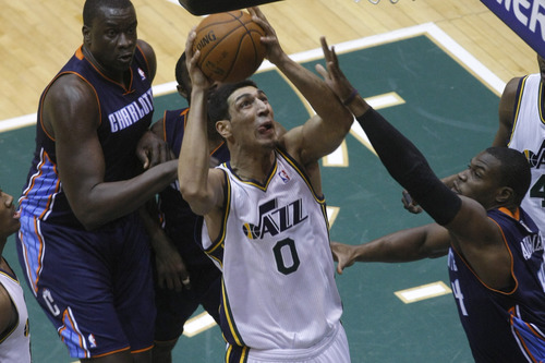 Chris Detrick  |  The Salt Lake Tribune Utah Jazz center Enes Kanter (0) shoots past Charlotte Bobcats small forward Jeff Adrien (4) and Charlotte Bobcats shooting guard Jeffery Taylor (44) during the first half of the game at EnergySolutions Arena Friday March 1, 2013.