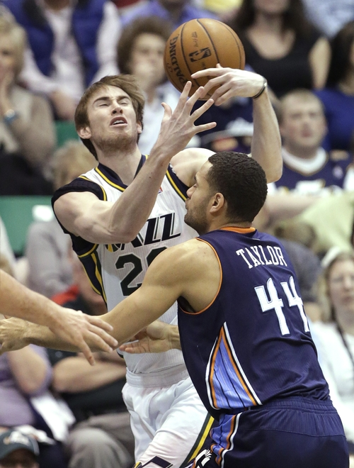 Utah Jazz's Gordon Hayward, left, fumbles the ball as Charlotte Bobcats' Jeffery Taylor (44) defends in the first quarter during an NBA basketball game, Friday, March 1, 2013, in Salt Lake City. (AP Photo/Rick Bowmer)