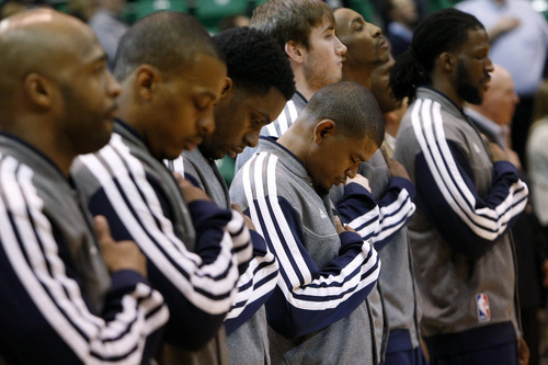 Chris Detrick  |  The Salt Lake Tribune Members of the Utah Jazz team listen during the National Anthem before the game at EnergySolutions Arena Friday March 1, 2013.