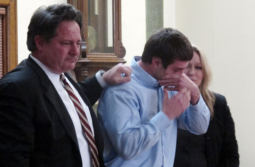 Former University of Montana quarterback, Jordan Johnson, center, reacts after being acquitted of rape charges during his trial Friday March 1, 2013 in Missoula, Mont. With Johnson are his attorneys, David Paoli and Kirsten Pabst. The accusations against Johnson, 20, have drawn much attention in Montana, where UM football is the top sports attraction. Jurors deliberated for less than two hours. (AP Photo/Matt Gouras)