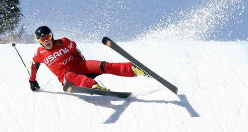 Rick Egan  | The Salt Lake Tribune   Sarah Lepine takes a tumble as she attempts to land the last jump in the consolation final of the Ladies Ski Cross at the Canyons, Friday, March 1, 2013.