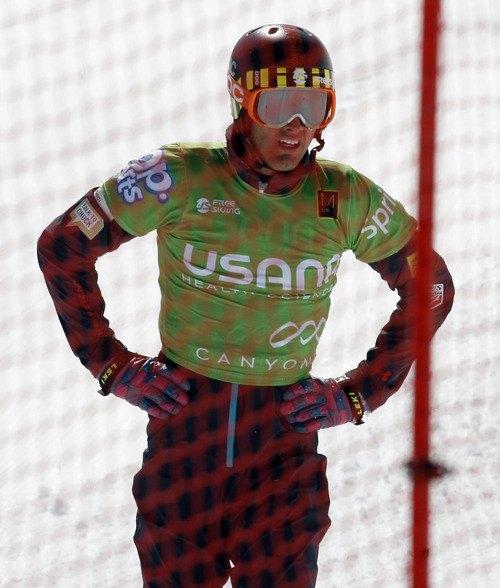 Rick Egan  | The Salt Lake Tribune   Trevor Ricioli (green) gets back on his feet after crashing through the fence in race six, in the Men's Ski Cross at the Canyons, Friday, March 1, 2013.