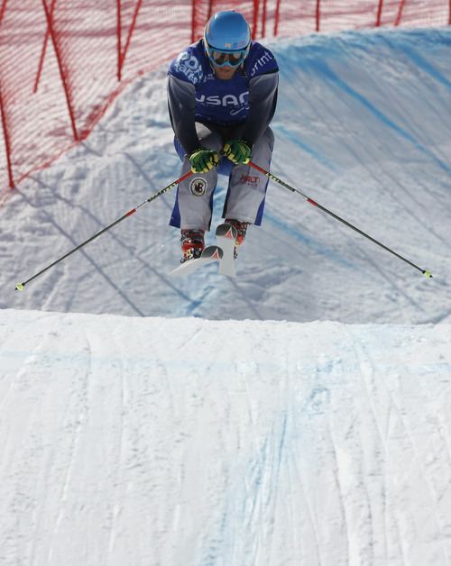 Rick Egan  | The Salt Lake Tribune   Brant Crossan (blue) hits the jump all alone, as Trevor Ricioli and Joe Swensson crashed through the fence on the turn in race six, in the Men's Ski Cross at the Canyons, Friday, March 1, 2013.
