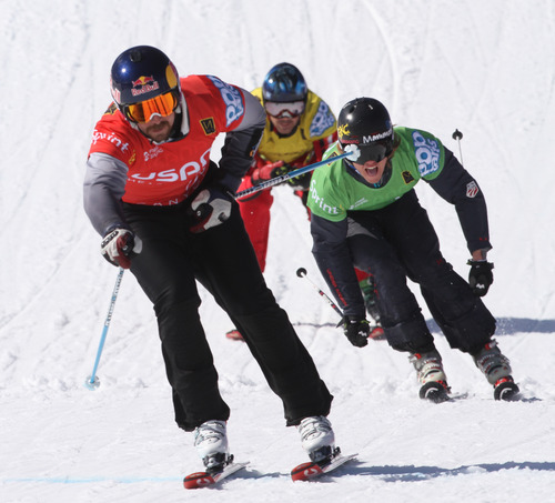 Rick Egan  | The Salt Lake Tribune   John Teller (red) leads the pack to the finshline followed by Tyler Wallash (green) and Stanley Hayer (yellow) in the final race of the in the Men's Ski Cross at the Canyons, Friday, March 1, 2013. Teller finished in first place.