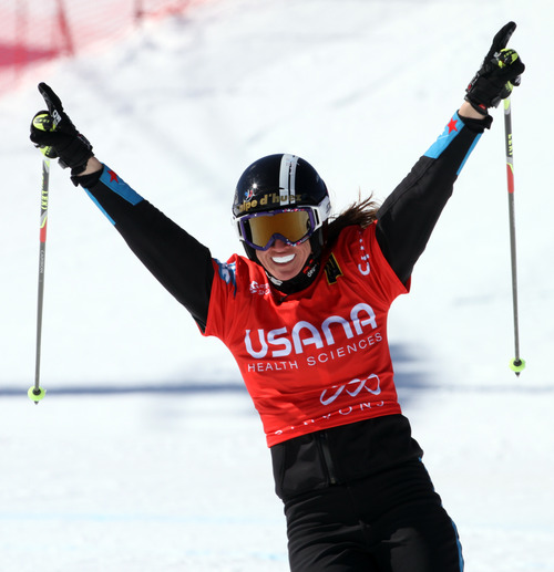 Rick Egan  | The Salt Lake Tribune   David Ophelie celebrates as she crosses the finish line for the first place finish in the Ladies Ski Cross at the Canyons, Friday, March 1, 2013.