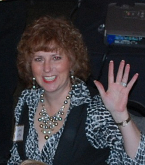 This undated image provided by Sue VanRuff shows Sandra Sutton-Wasmund, a businesswoman from Washington state who was killed in Las Vegas when the Maserati driven by Kenneth Cherry Jr. slammed into the taxicab she was riding in, after Cherry was allegedly shot by a man in a SUV.  Cherry and the driver of the taxi were also killed. Ammar Harris, the alleged shooter, was arrested Thursday in Los Angeles. (AP Photo/Courtesy Sue VanRuff)