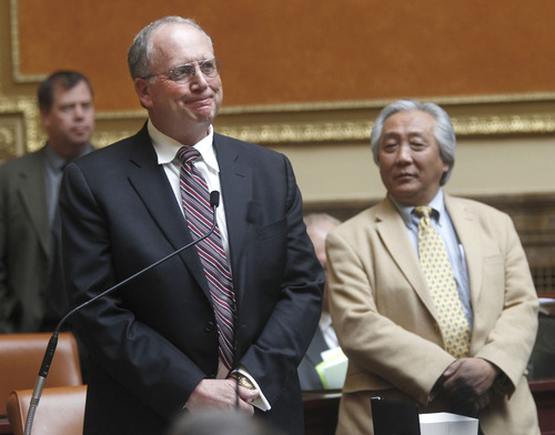 Al Hartmann  |  The Salt Lake Tribune Rep. John Mathis, R-Vernal, sponsor of HB78, Concealed Weapon Carry  Amendments, left, waits as members of the Utah House of Representatives vote on his bill Friday March 1.  Rep Curtis Oda, R-Clearfield, right.