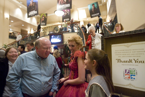 "Kim Raff  |  The Salt Lake Tribune Patron Gary A. Lynn, left, compliments actresses Brittany Sanders, center, and Olivia Smith-Driggs, right, after a sold-out production of ""Chitty Chitty Bang Bang"" at Hale Centre Theatre in West Valley City on Thursday. Hale Centre Theatre made a head-turning request to the Utah Legislature for $2 million toward the estimated $65 million cost of its new theater. Citing its mission to provide affordable live theater to Utah audiences, plus consecutive sold-out seasons, Hale officials have decided to move to Sandy, where they plan to build a $65 million, three-stage venue that will have triple the seats of its current theater."