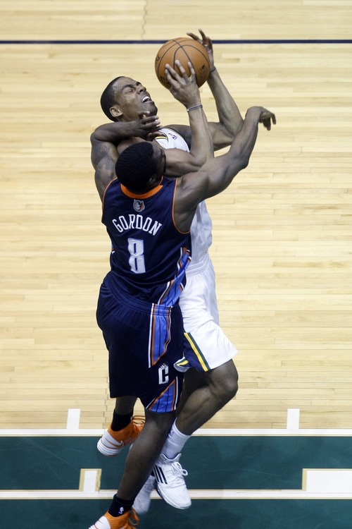 Chris Detrick  |  The Salt Lake Tribune Utah Jazz point guard Alec Burks (10) is fouled by Charlotte Bobcats shooting guard Ben Gordon (8) during the first half of the game at EnergySolutions Arena Friday March 1, 2013.
