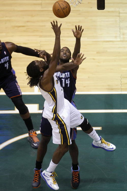 Chris Detrick  |  The Salt Lake Tribune Utah Jazz small forward DeMarre Carroll (3) shoots past Charlotte Bobcats small forward Michael Kidd-Gilchrist (14) during the first half of the game at EnergySolutions Arena Friday March 1, 2013.