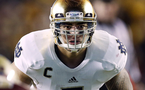 FILE - In this Nov. 10, 2012, file photo, Notre Dame linebacker Manti Te'o waits for the snap during the second half of Notre Dame's 21-6 win over Boston College in a NCAA college football game in Boston. (AP Photo/Winslow Townson, File)