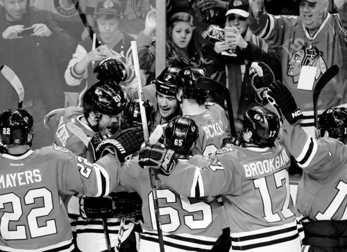 Chicago Blackhawks' Brent Seabrook, center, celebrates with teammates after scoring his game-winning goal during the overtime of an NHL hockey game against the Columbus Blue Jackets in Chicago, Friday, March 1, 2013. The Blackhawks won 4-3. (AP Photo/Nam Y. Huh)