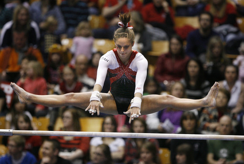 Scott Sommerdorf   |  The Salt Lake Tribune Utah's Breanna Hughes during her 9.850 performance on the uneven parallel bars. The Utah Red Rocks won a tri meet versus BYU and North Carolina State at BYU, Friday, March 1, 2013. Utah finished with 197.125 points to BYU's 195.000, and N.C.St. with 194.675.