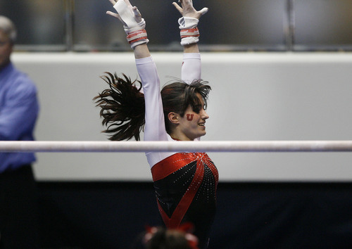 Scott Sommerdorf   |  The Salt Lake Tribune Utah's Nansy Damianova celebrates her 9.875 performance on the uneven parallel bars. The Utah Red Rocks won a tri meet versus BYU and North Carolina State at BYU, Friday, March 1, 2013. Utah finished with 197.125 points to BYU's 195.000, and N.C.St. with 194.675.