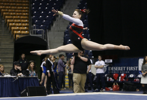 Scott Sommerdorf   |  The Salt Lake Tribune Utah's Becky Tutka during her 9.95 winning performance in floor exercise. The Utah Red Rocks won a tri meet versus BYU and North Carolina State at BYU, Friday, March 1, 2013. Utah finished with 197.125 points to BYU's 195.000, and N.C.St. with 194.675.
