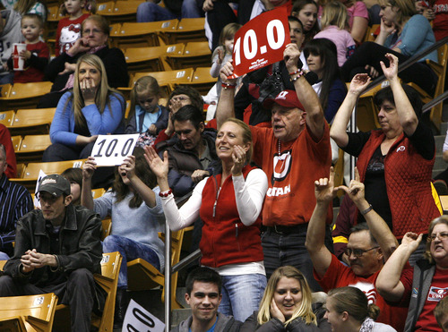 Scott Sommerdorf   |  The Salt Lake Tribune Utah fans cheer the Utah Red Rocks won a tri meet versus BYU and North Carolina State at BYU, Friday, March 1, 2013. Utah finished with 197.125 points to BYU's 195.000, and N.C.St. with 194.675.