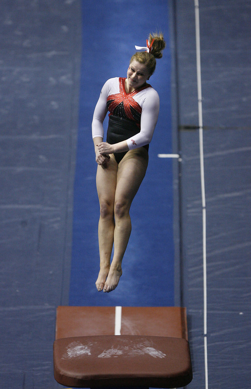 Scott Sommerdorf   |  The Salt Lake Tribune Utah's Tory Wilson hits a 9.950 performance on the vault. She won individual titles in vault, beam and all-around as The Utah Red Rocks won a tri meet versus BYU and North Carolina State at BYU, Friday, March 1, 2013. Utah finished with 197.125 points to BYU's 195.000, and N.C.St. with 194.675.