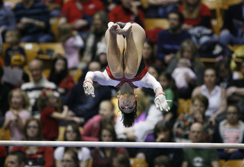Scott Sommerdorf   |  The Salt Lake Tribune Utah's Nansy Damianova finishes her 9.875 performance on the uneven parallel bars. The Utah Red Rocks won a tri meet versus BYU and North Carolina State at BYU, Friday, March 1, 2013. Utah finished with 197.125 points to BYU's 195.000, and N.C.St. with 194.675.