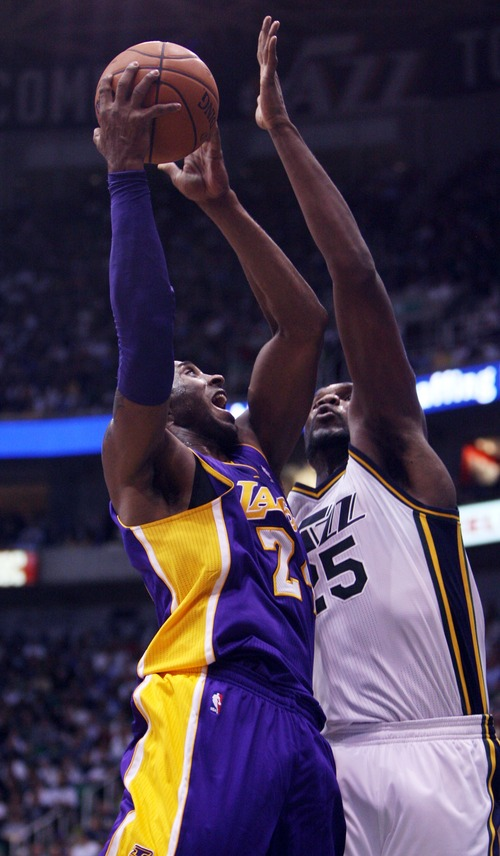 Kim Raff | The Salt Lake Tribune Los Angeles Lakers shooting guard Kobe Bryant (24) takes a shot as Utah Jazz center Al Jefferson (25) defends during a game at EnergySolutions Arena in Salt Lake City, Utah on November 7, 2012. Jazz went on to win the game 95-86.